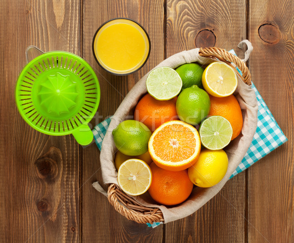 Citrus fruits and glass of juice. Oranges, limes and lemons Stock photo © karandaev