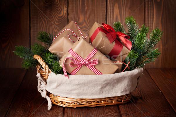 Christmas gifts and tree branch Stock photo © karandaev