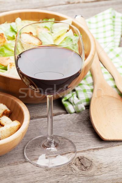 Red wine glass and caesar salad Stock photo © karandaev