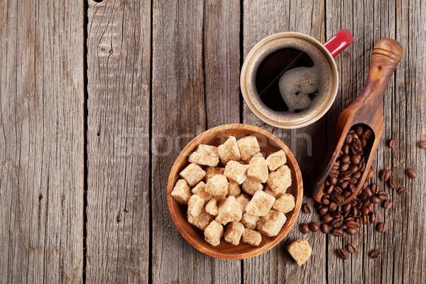 Kahve fincanı fasulye esmer şeker ahşap masa üst görmek Stok fotoğraf © karandaev