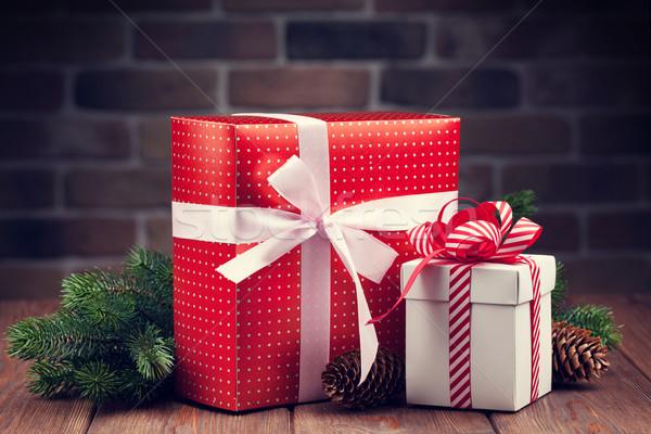 Karácsony ajándékdobozok faág fenyőfa ág fa asztal Stock fotó © karandaev