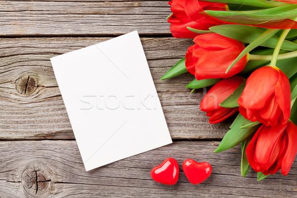 Piros tulipánok valentin nap üdvözlőlap fa asztal kilátás Stock fotó © karandaev