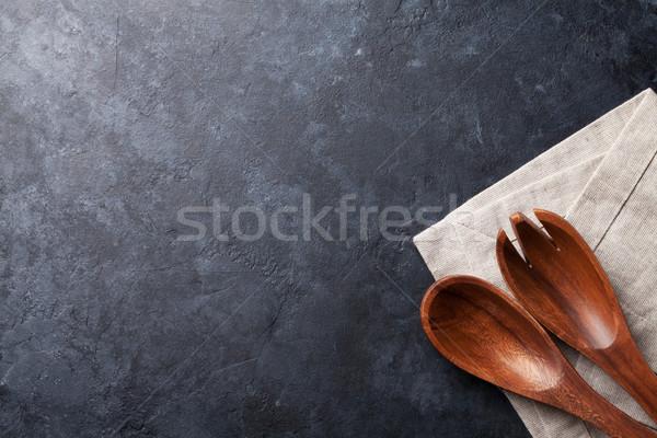 Cooking utensils on stone table Stock photo © karandaev