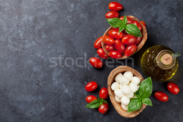 Mozzarella cheese, tomatoes and basil Stock photo © karandaev