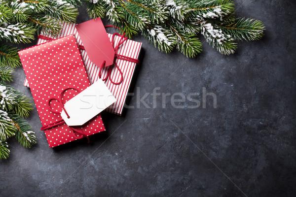 Christmas gift boxes and fir tree on stone table Stock photo © karandaev