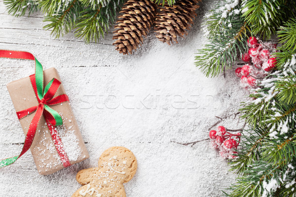 Christmas gift, gingerbread man, candy canes and fir tree Stock photo © karandaev