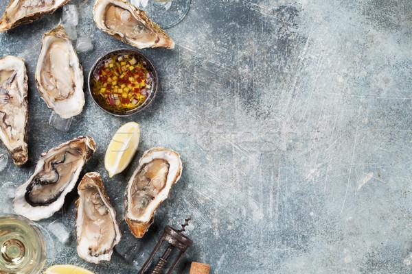 Fresh oysters and white wine Stock photo © karandaev