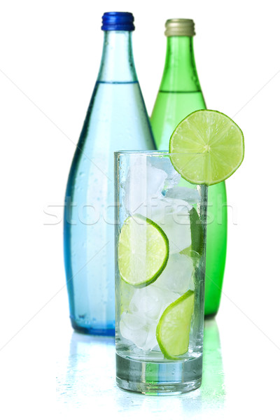 Glass of water with lime and ice Stock photo © karandaev