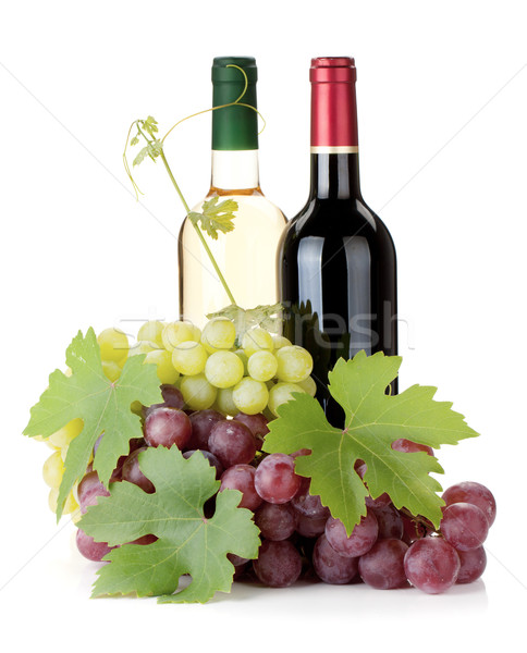 Two wine bottles and grapes Stock photo © karandaev
