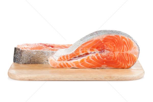 Salmon steaks on cutting board Stock photo © karandaev
