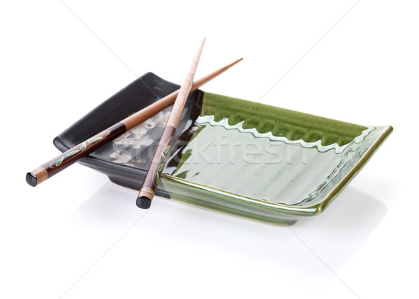 Chopsticks and plate Stock photo © karandaev