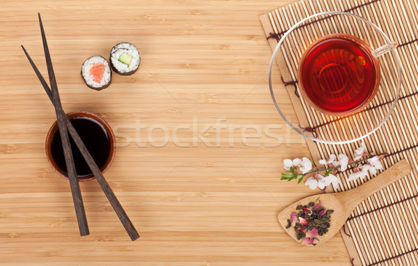 Sushi maki set, herbal tea and sakura branch Stock photo © karandaev
