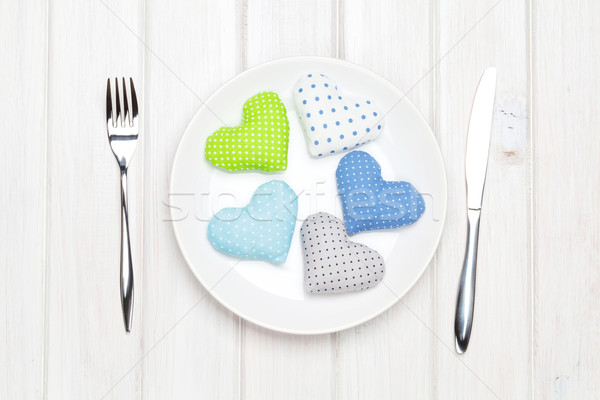 Valentines day toy hearts on plate and silverware. View from abo Stock photo © karandaev