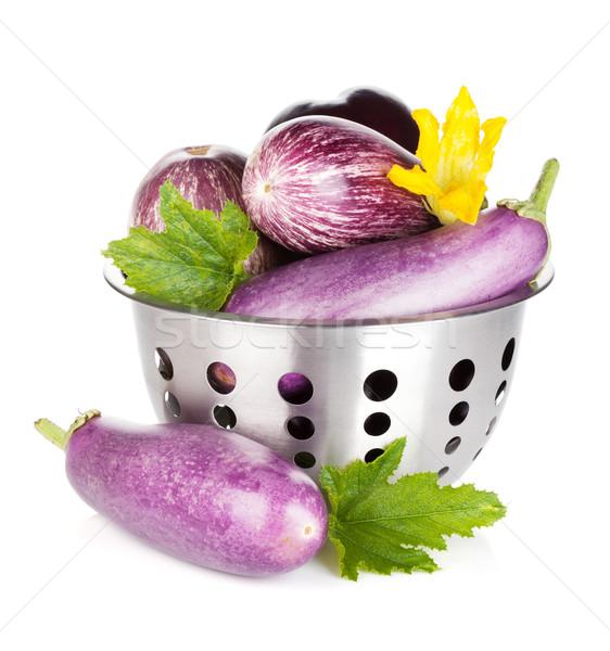Fresh ripe eggplants in colander Stock photo © karandaev