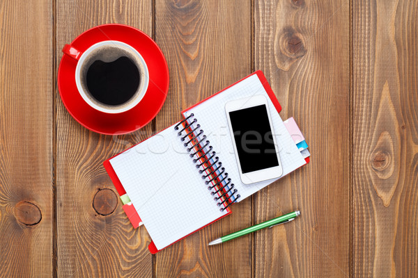 Stock photo: Office desk table with supplies and coffee cup