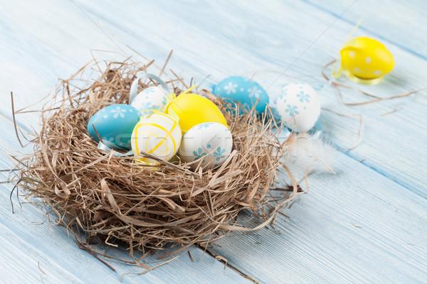 Húsvét kártya színes tojások fészek fa asztal Stock fotó © karandaev