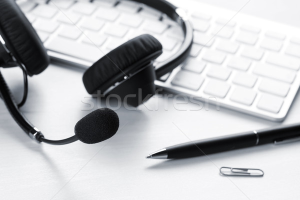 Office desk with headset and keyboard Stock photo © karandaev