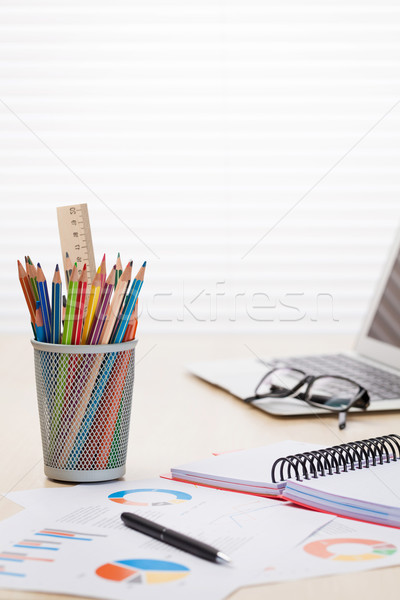 Office desk workplace with laptop, reports and pencils Stock photo © karandaev