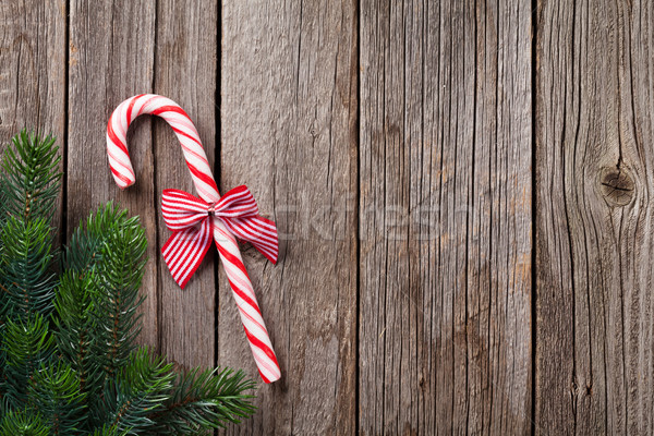 Christmas candy cane on wooden table Stock photo © karandaev