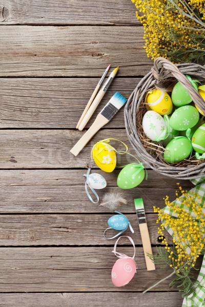 Coloré œufs de Pâques table en bois haut vue espace de copie Photo stock © karandaev