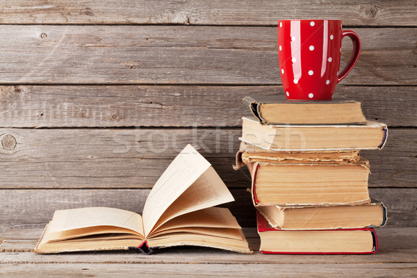 Old books and coffee cup Stock photo © karandaev