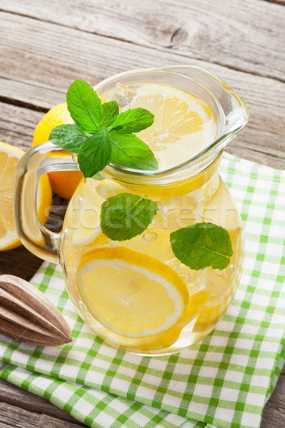 Lemonade with lemon, mint and ice Stock photo © karandaev