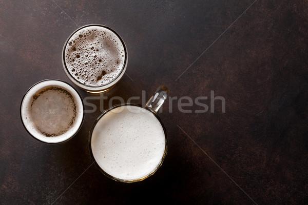 Világos sör sör kő asztal felső kilátás Stock fotó © karandaev