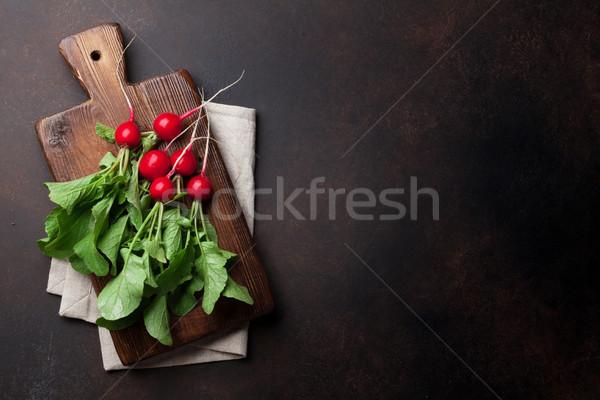 Giardino ravanello fresche tagliere top view Foto d'archivio © karandaev
