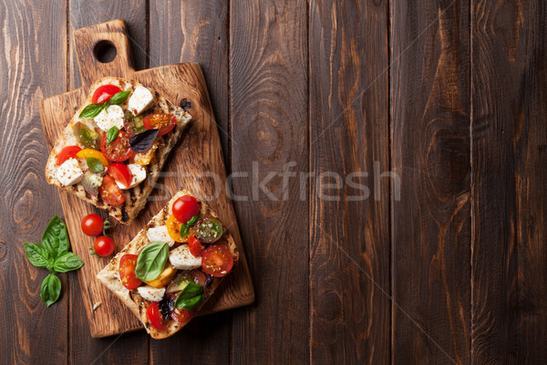 Bruschetta pomodori mozzarella basilico pomodorini Foto d'archivio © karandaev