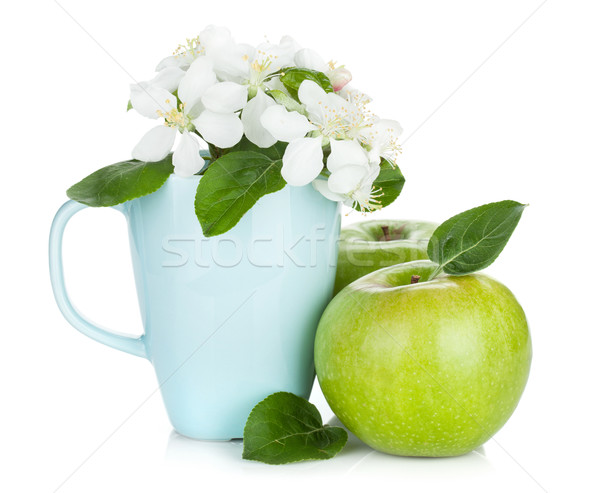 Stock photo: Ripe green apples and flowers in cup
