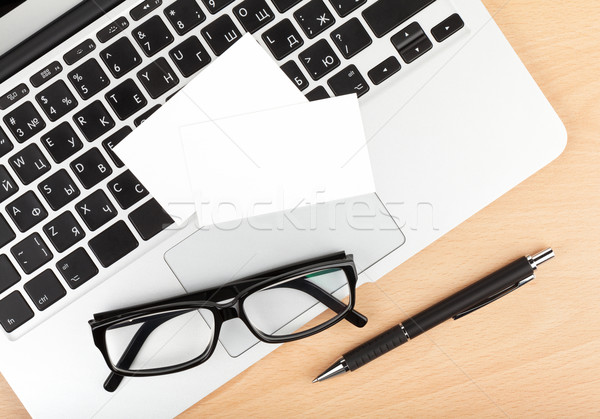 Blank business cards over laptop on office table Stock photo © karandaev