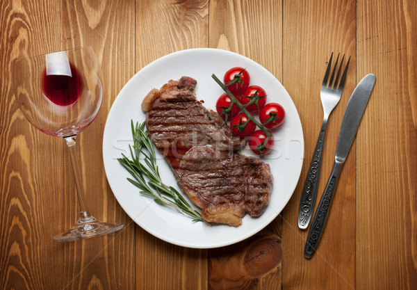 Sirloin steak with rosemary and cherry tomatoes on a plate Stock photo © karandaev