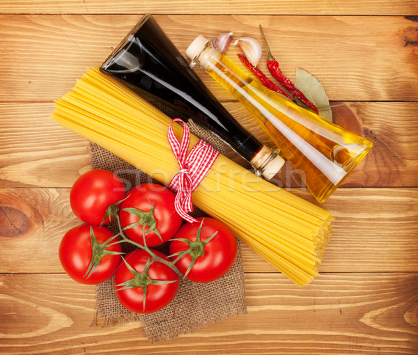 Pasta, tomatoes, condiments and spices Stock photo © karandaev