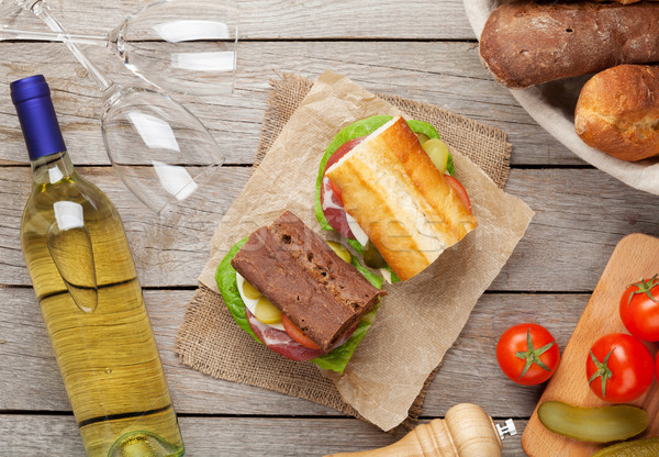 Two sandwiches with salad, ham, cheese and tomatoes with white w Stock photo © karandaev