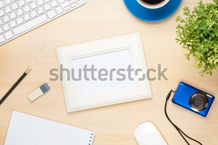 Photo frame on office table with notepad, computer and camera Stock photo © karandaev