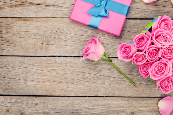 Valentines day background with gift box full of pink roses stock ...