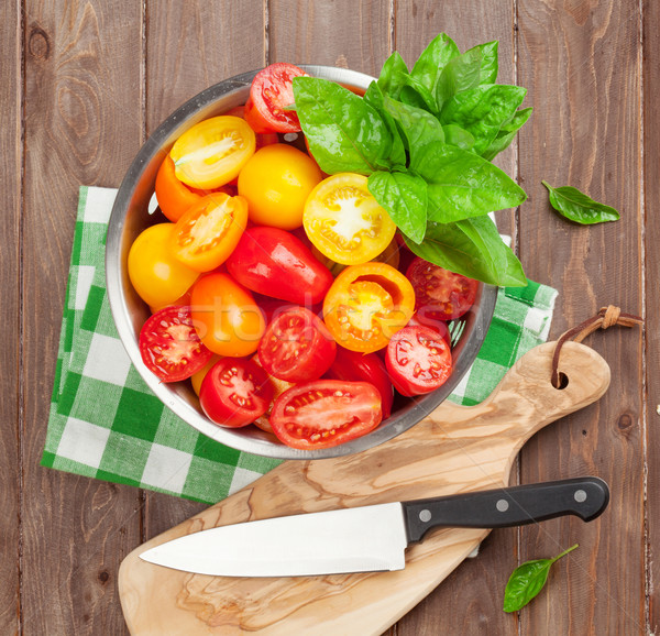 Fresh colorful tomatoes and basil in colander Stock photo © karandaev