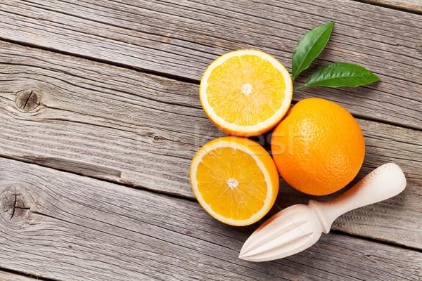 Fresh ripe oranges and juicer Stock photo © karandaev