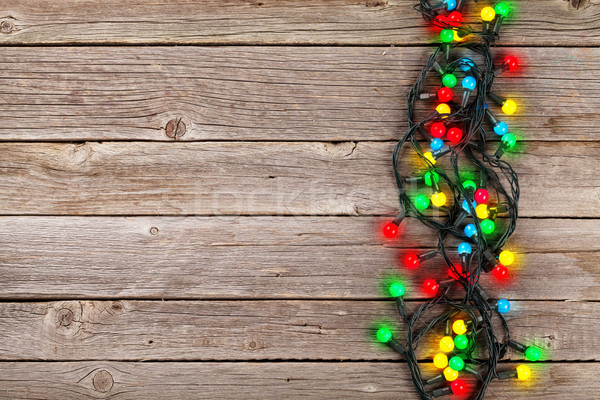Christmas colorful lights over wooden background Stock photo © karandaev