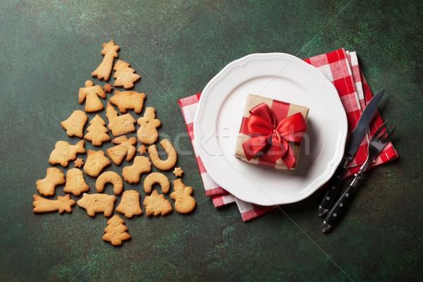 Karácsony vacsora tányér ezüst étkészlet ajándék sütik Stock fotó © karandaev