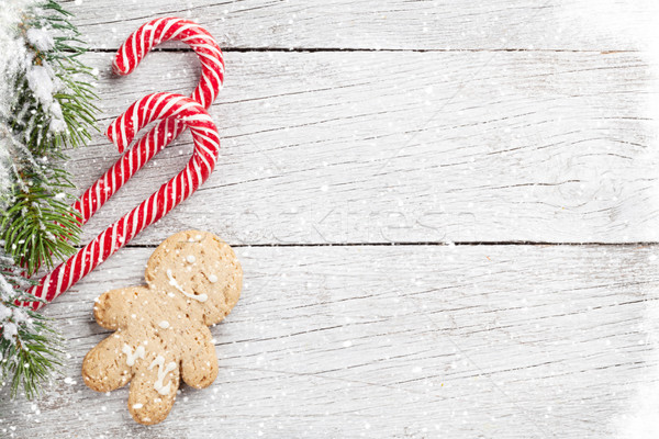 Christmas tree, candy cane and gingerbread man Stock photo © karandaev