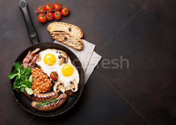 Angol reggeli sült tojások kolbászok szalonna Stock fotó © karandaev
