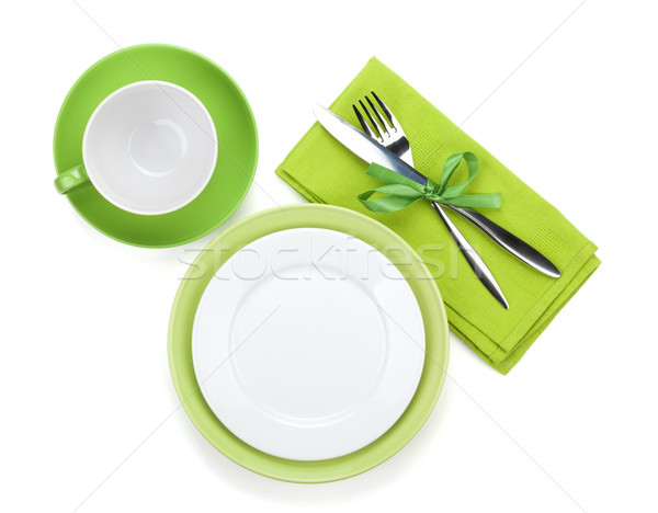 Empty green plates, coffee cup and silverware Stock photo © karandaev