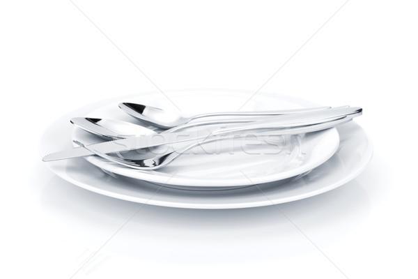 Silverware or flatware set over plates Stock photo © karandaev
