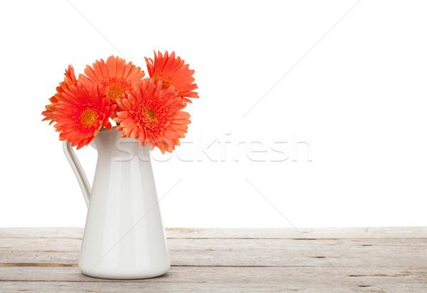 Сток-фото: оранжевый · цветы · деревянный · стол · изолированный · белый · древесины