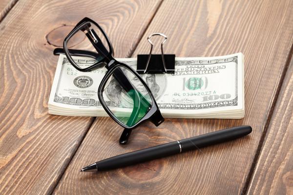 Money cash, glasses and pen Stock photo © karandaev