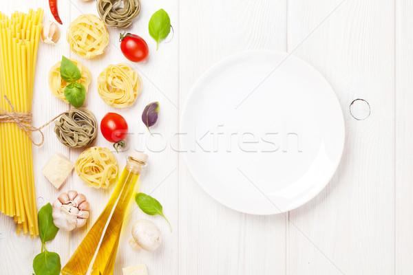 Cucina italiana cottura ingredienti vuota piatto pasta Foto d'archivio © karandaev