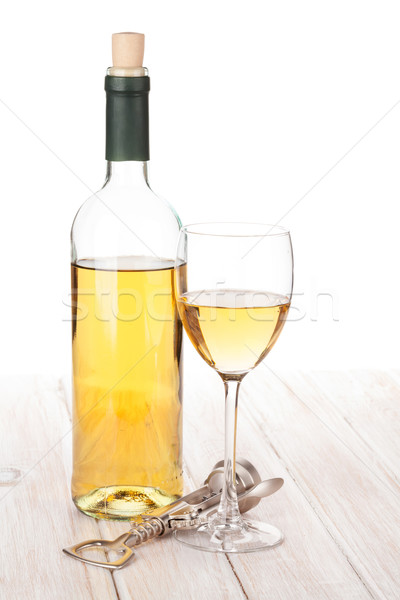 White wine glass, bottle and corkscrew Stock photo © karandaev
