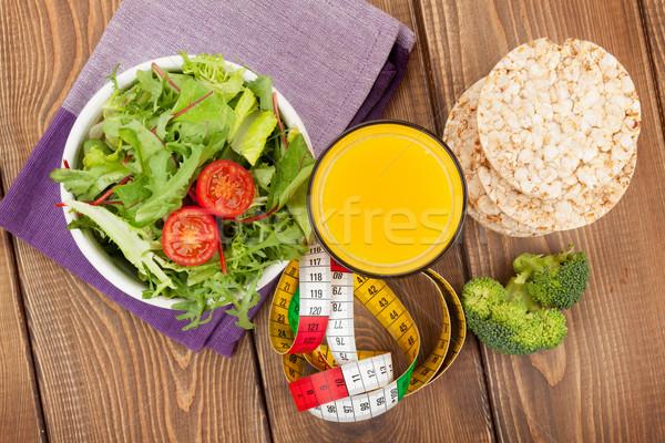 Zdrowa żywność centymetrem drewniany stół fitness zdrowia żywności Zdjęcia stock © karandaev