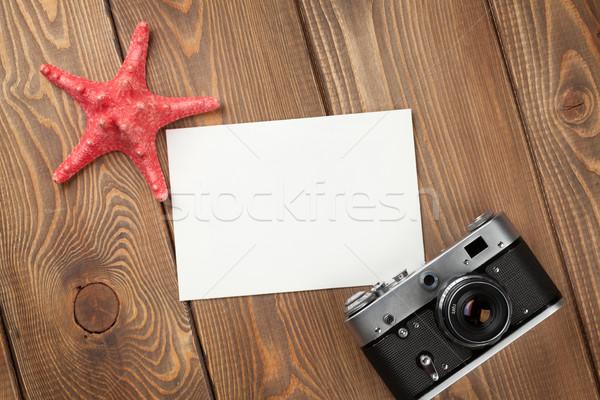 Viajar férias photo frame starfish câmera mesa de madeira Foto stock © karandaev